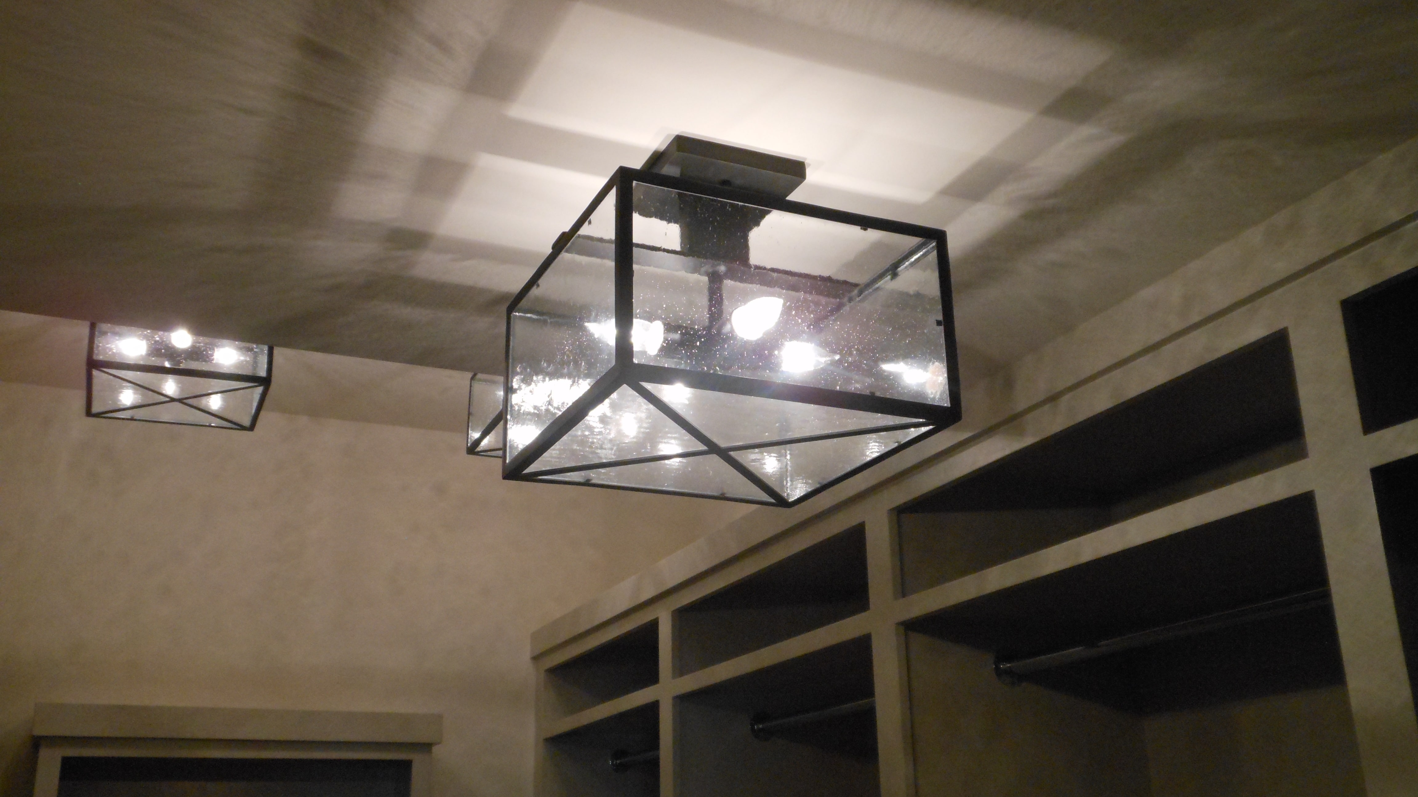 Custom designed Wine Cellar Lighting Fixture with wrought iron, clear seedy glass, and antique black finish.